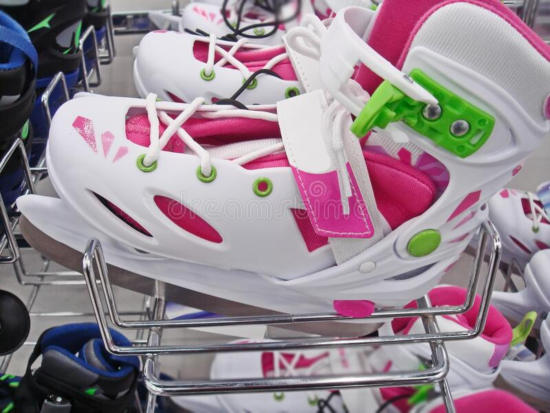 Bright skates for girls with a sliding size adjustment system and impact-resistant construction. For children who go to the skatin. G rink in winter for fun royalty free stock images