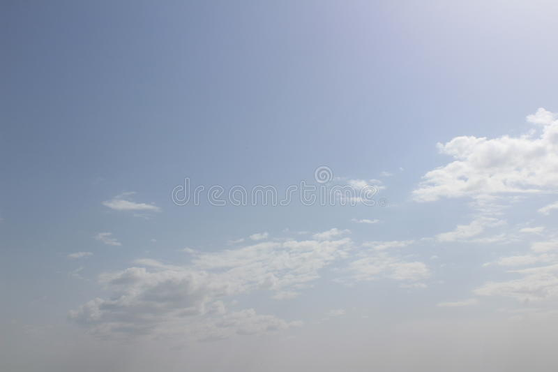 Bright sky line with summer clouds stock photos