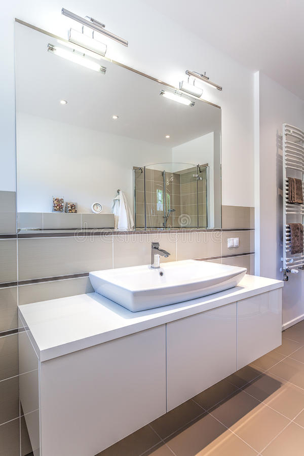 Bright space - modern ladies room. Bright space - a white modern ladies room with a big mirror stock photo