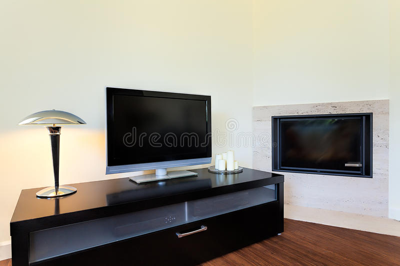 Bright space - television set and fireplace royalty free stock photo
