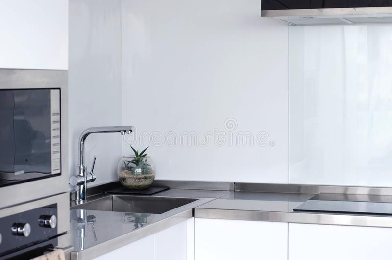 Bright and spacious fashionable kitchen with new appliances. House. Modern style stock photos