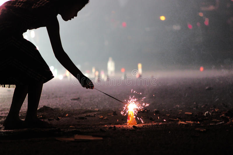 Bright sparkler firework in hand royalty free stock photography