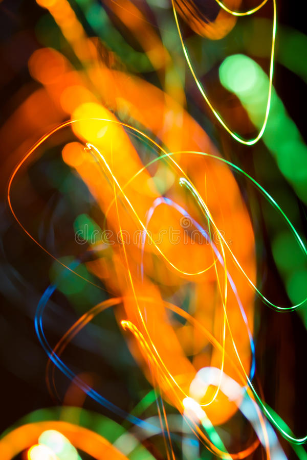 Bright sparks on colorful background with bokeh effect. An image of bright sparks on colorful background with bokeh effect royalty free stock photos
