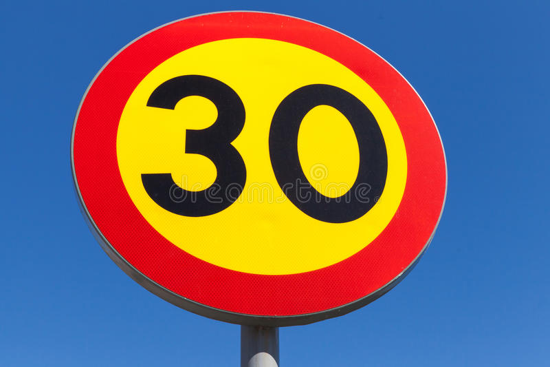 Bright speed limit road sign over blue sky royalty free stock photos