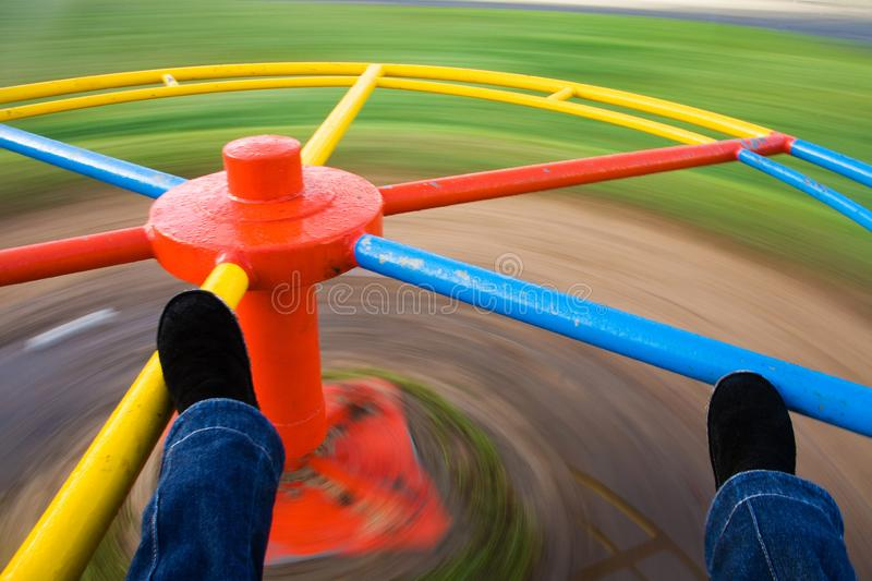 Bright spinning merry-go-round in play park royalty free stock image