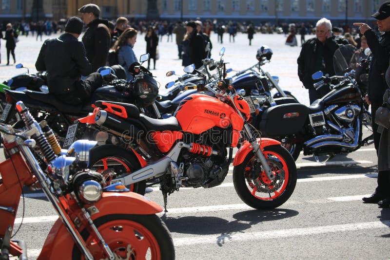 Bright sports bike Yamaha among other motorcycles. Palace Square stock photography