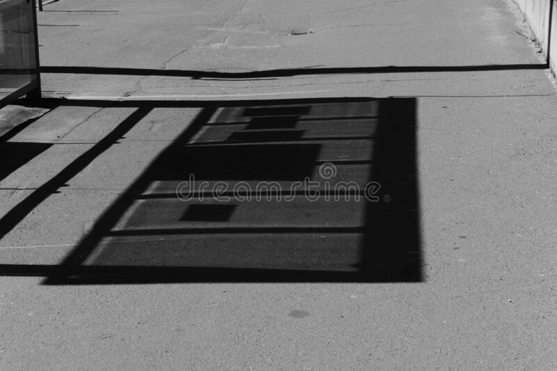 On a bright spring day - a play of light from the sun, casting a shadow on the stop. On a bright spring day - a play of light from the rays of the sun, which royalty free stock images