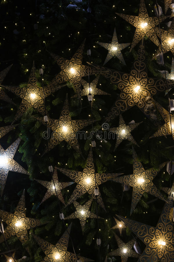 Bright star on a Christmas tree. Garlands stock image