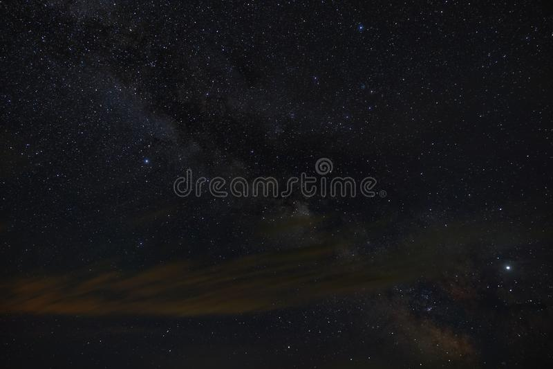 Bright stars of the Milky Way galaxy in the night sky. Outer space photographed with long exposure.  stock photo
