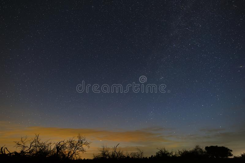 Bright stars in the night sky before dawn. Outer space photographed with long exposure.  stock photos