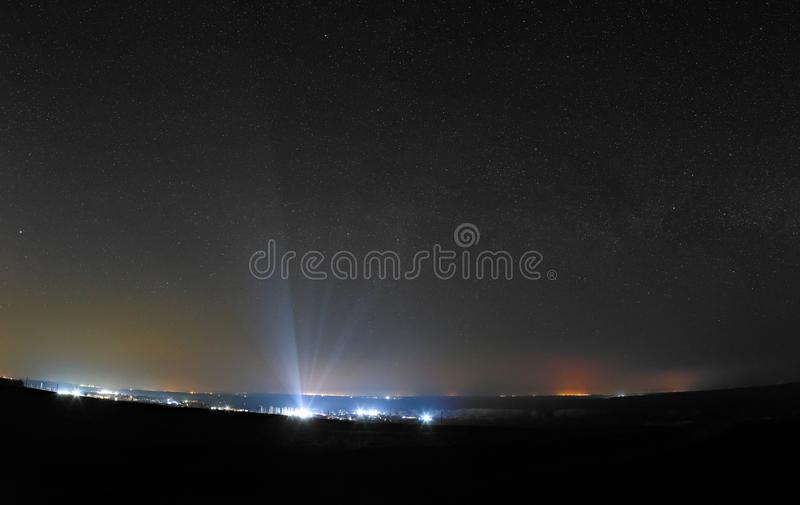 Bright stars in the night sky over the city. Light pollution from street lamps.  royalty free stock image