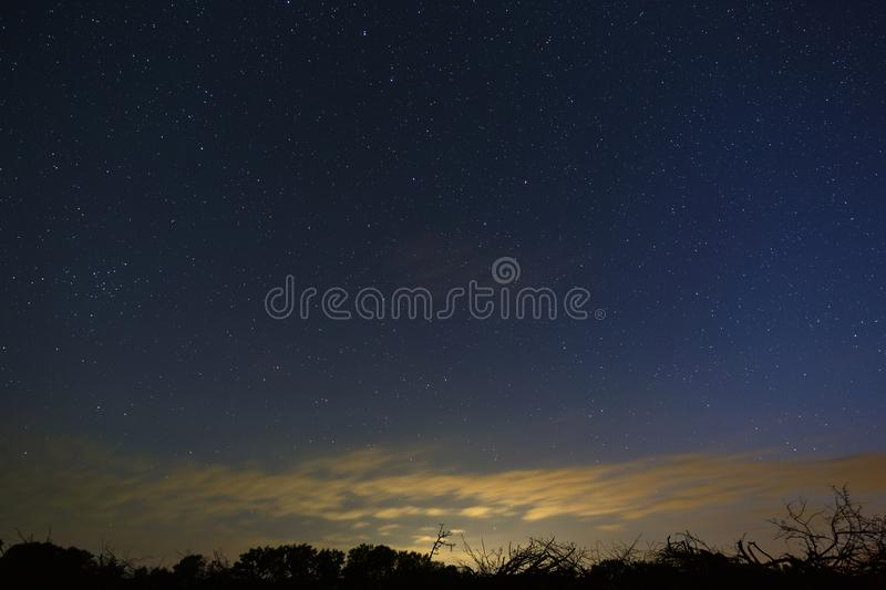 Bright stars in the night sky after sunset. Outer space photographed with long exposure.  stock photography