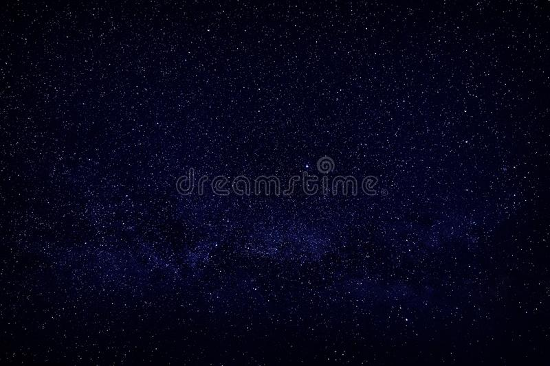 Bright stars in the night sky, view of open space.  royalty free stock image
