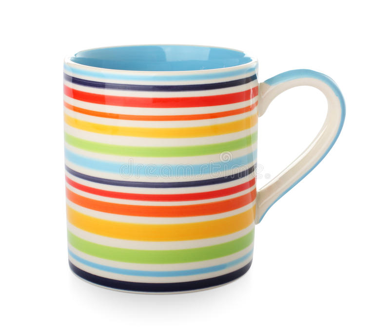 Bright striped mug. On a white royalty free stock photos