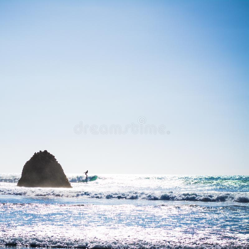Bright summer afternoon at Piha Beach, New Zealand royalty free stock image