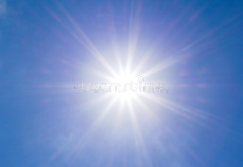 Bright sun on the blue sky. Without cloud stock photography