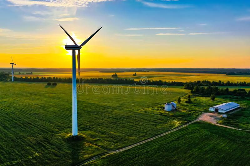 Bright sun in blue sky above farmlands, aerial landscape. Renewable energy source. Bright sun in the blue sky above farmlands, aerial landscape. Renewable energy royalty free stock image