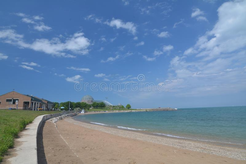 Chicago lakefront beach with blue sky stock images