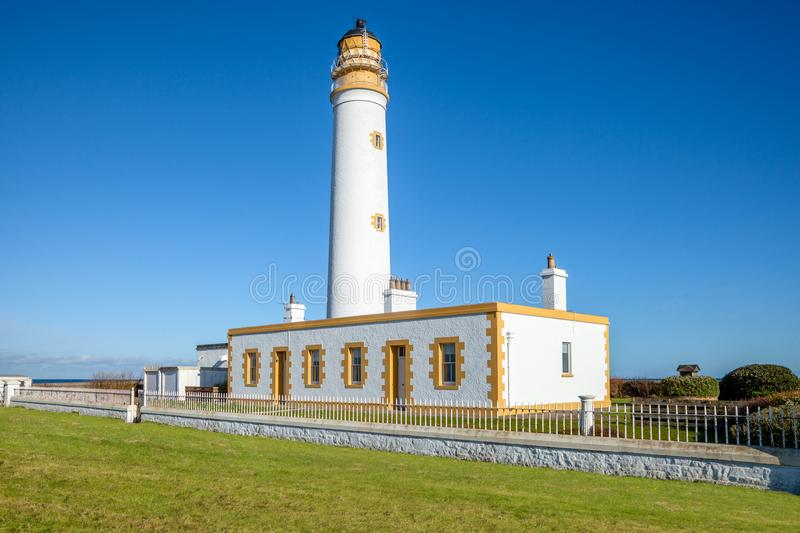 Barns Ness lighthouse Scotland. Bright and sunny image of Barns Ness lighthouse on the coast in Scotland royalty free stock photo