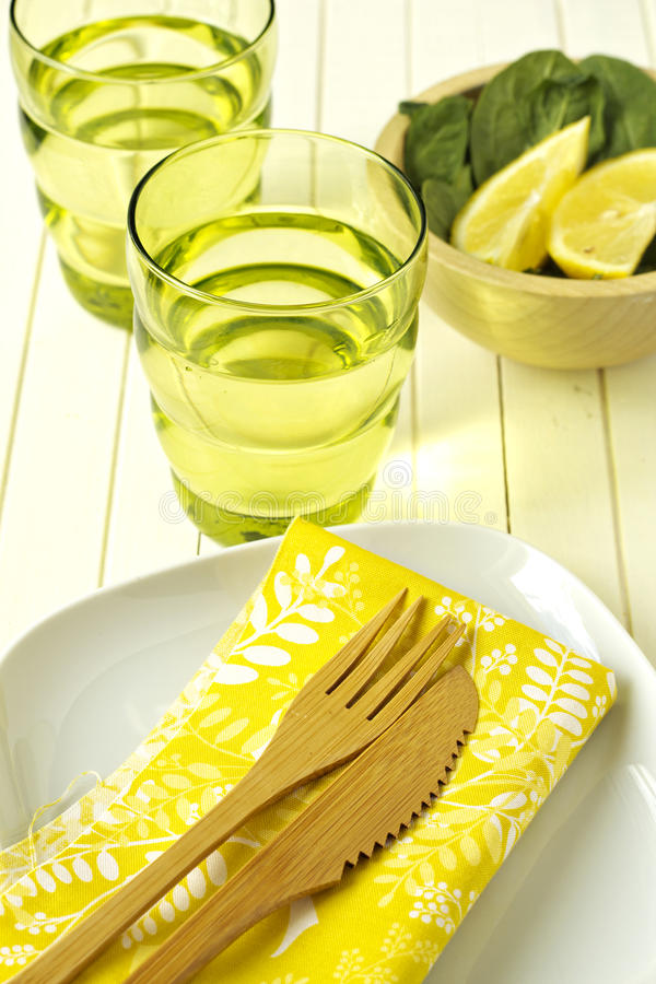 Bright and sunny table setting. With yellow napkin stock photos