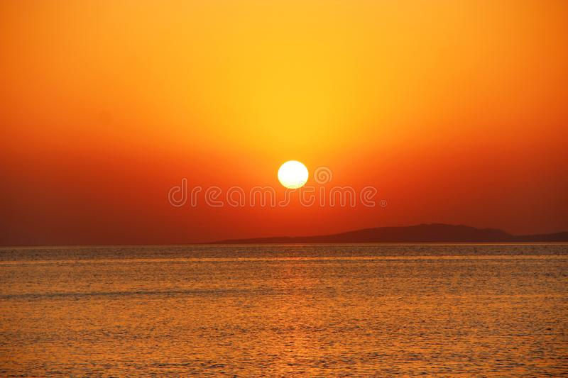 Bright sunset above sea. Beautiful red summer decline above ocean stock photos