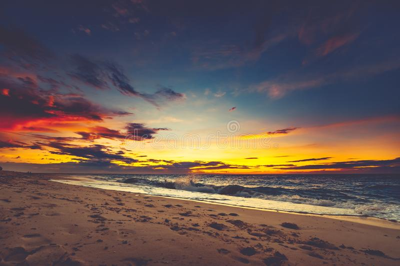 Bright sunset over the Asian shoreline. royalty free stock images