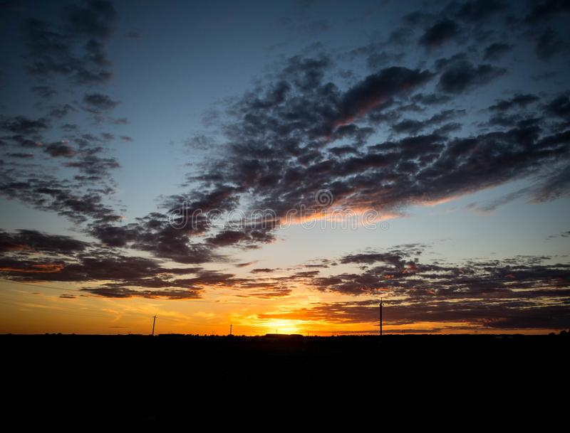 Bright sunset over a huge field. stock photography