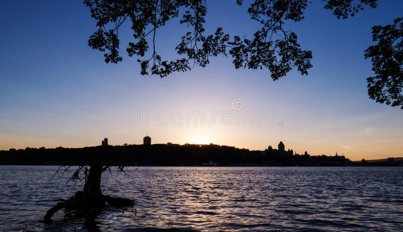 Bright Sunset From Quebec, Canada. Bright sunset with the landscape of a part of Quebec City and the Saint-Lawrence River, Canada royalty free stock image
