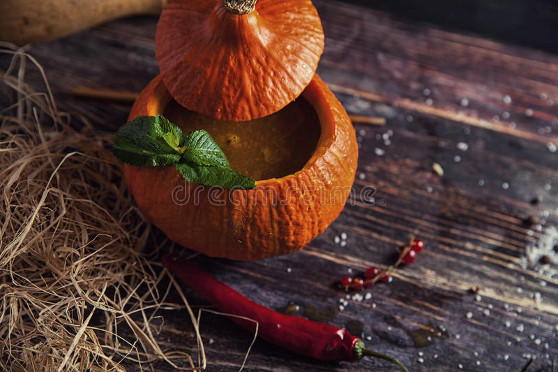 Bright tasty soup in pumpkin royalty free stock photo