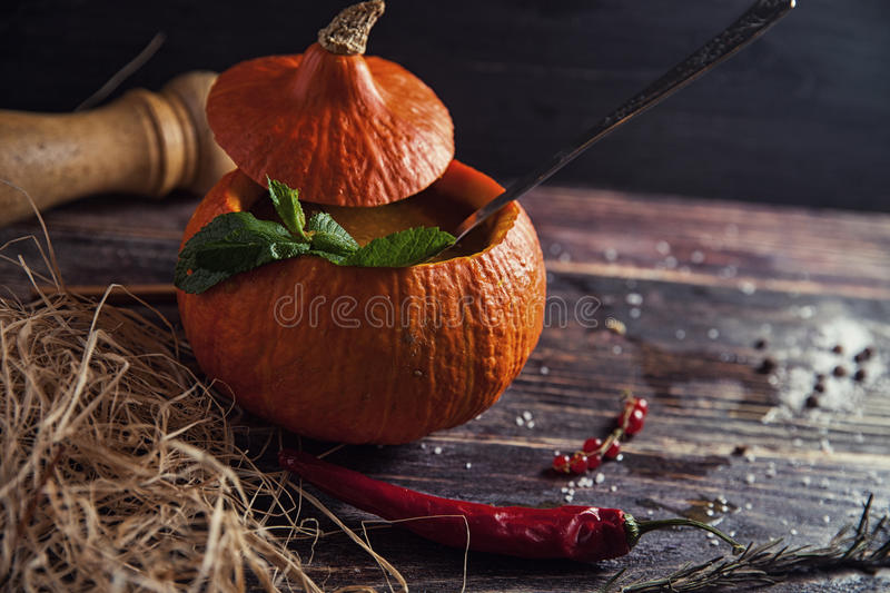 bright tasty soup in pumpkin stock images