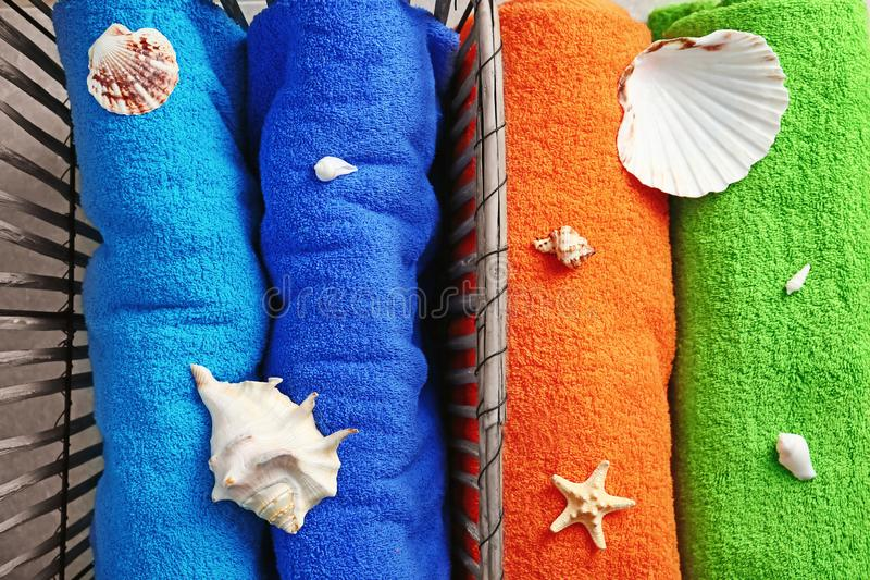 Bright terry towels with seashells, top view stock images