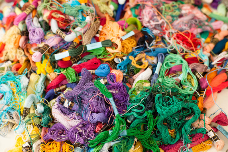 Bright threads for embroidery. stock photos