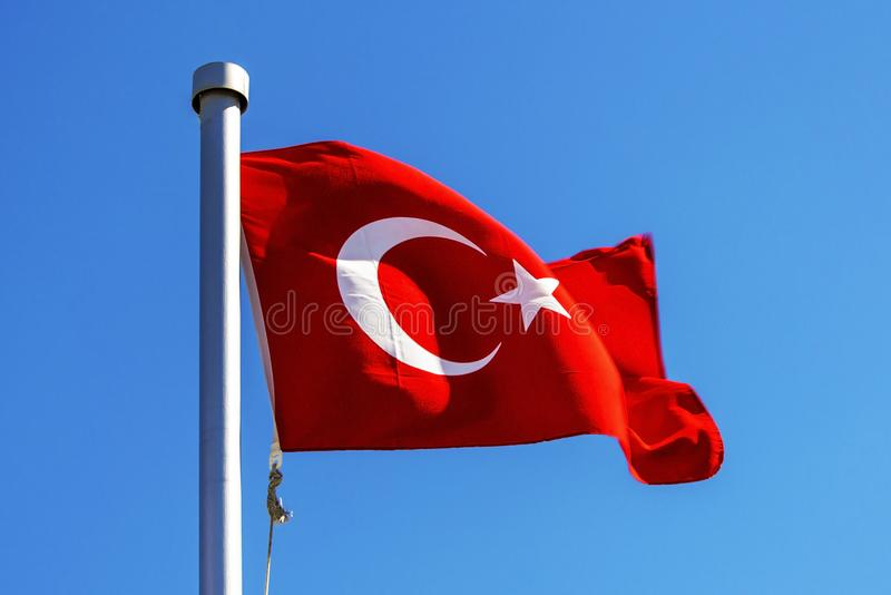 Bright Turkish flag waving in the wind royalty free stock photo