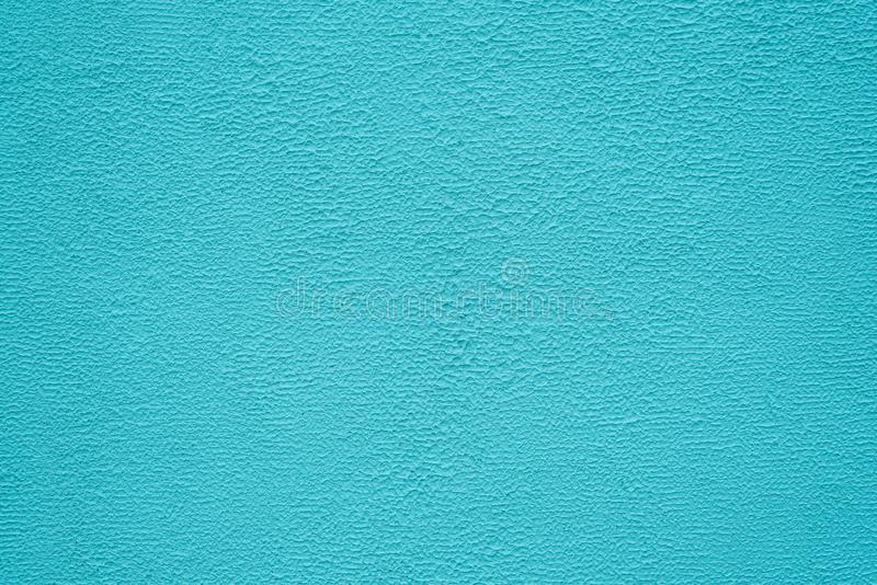 Bright turquoise stucco texture. Background. Bright turquoise fine texture of plaster. Background stock photos