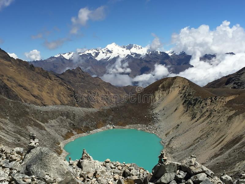 A bright turquoise lake on the Salkantay trek on the way to Macchu Picchu in the Peruvian Andes. Landscape view royalty free stock photo