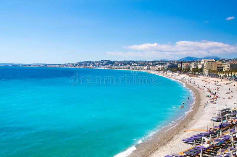 Bright turquoise water of Mediterranean sea in Nice, France. French riviera. Nice, beautiful beach, French Riviera, Cote d`Azur or Coast of Azure. Bright royalty free stock photo