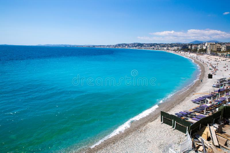 Bright turquoise water of Mediterranean sea in Nice, France. French riviera. Public beach. Nice, beautiful beach, French Riviera, Cote d`Azur or Coast of Azure royalty free stock photo