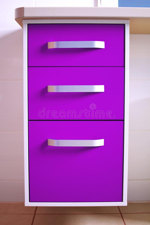 Bright ultra violet purple modern chest of drawers stock photo
