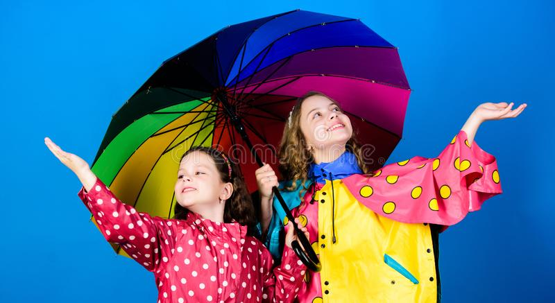 Bright umbrella. It is easier to be happy together. Be rainbow in someones cloud. Walk under umbrella. Kids girls happy royalty free stock photography