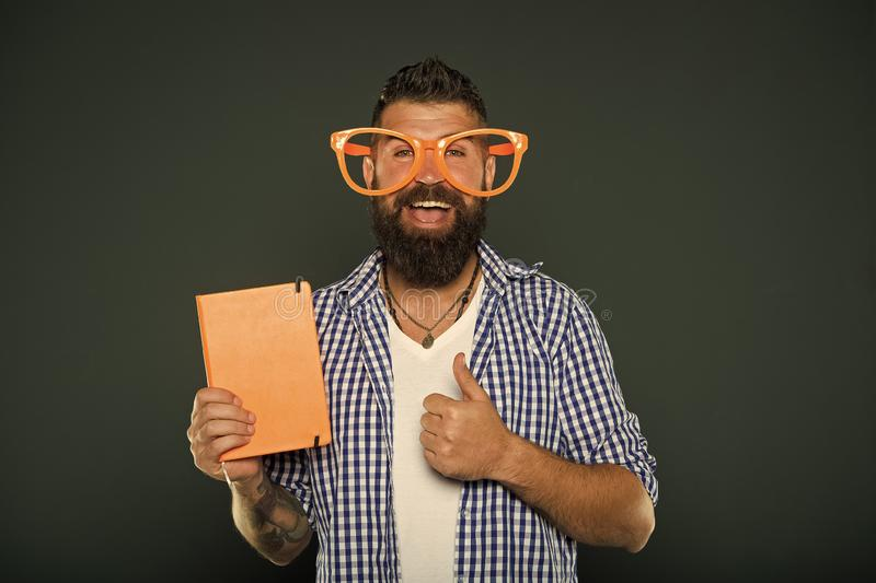 Bright up your day. Read this book. Comic and humor sense. Funny story. Study is fun. Funny book for relax. Book cover. Copy space. Hipster bearded man wear royalty free stock image