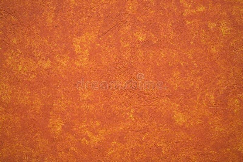 Bright Vibrant Orange Yellow Adobe Wall Mexico stock photography