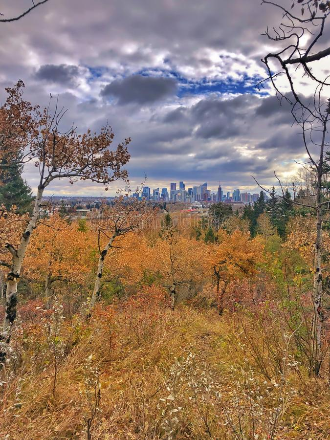 Dark Clouds Over A Fall City. A bright view of the downtown Calgary skyline during a fall cloudy day stock images
