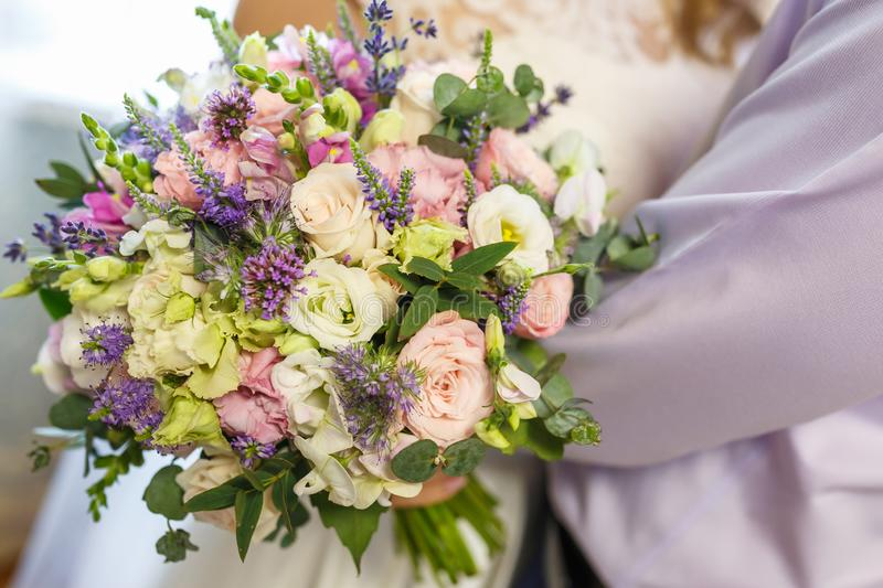 Bright wedding bouquet of summer white pink roses and orchid with violet wildflowers stock photography