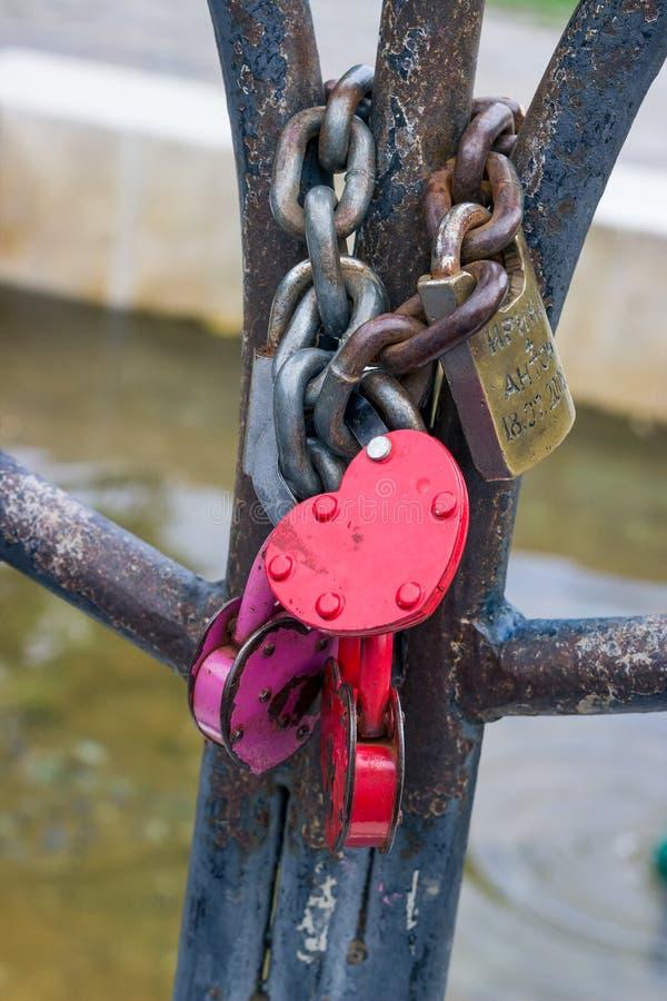 Bright wedding locks. On the railing of the bridge stock photo