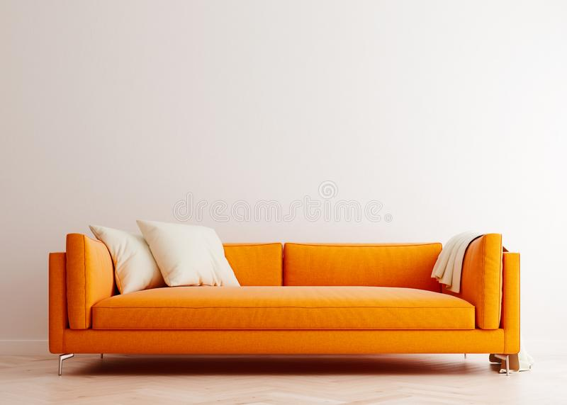 Bright white mock up wall with orange sofa in modern interior background, living room, Scandinavian style royalty free stock photography