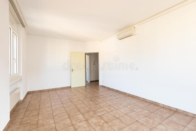 Bright white room with a door, concept stock image