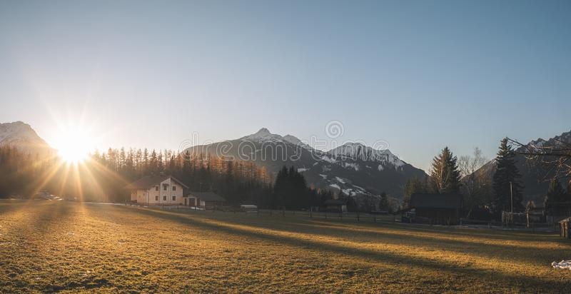 Bright winter scenery in alpine village at sunset. Winter panorama in the Alps mountains. Sunset over alpine village on a December evening, in Ehrwald, Austria stock photography