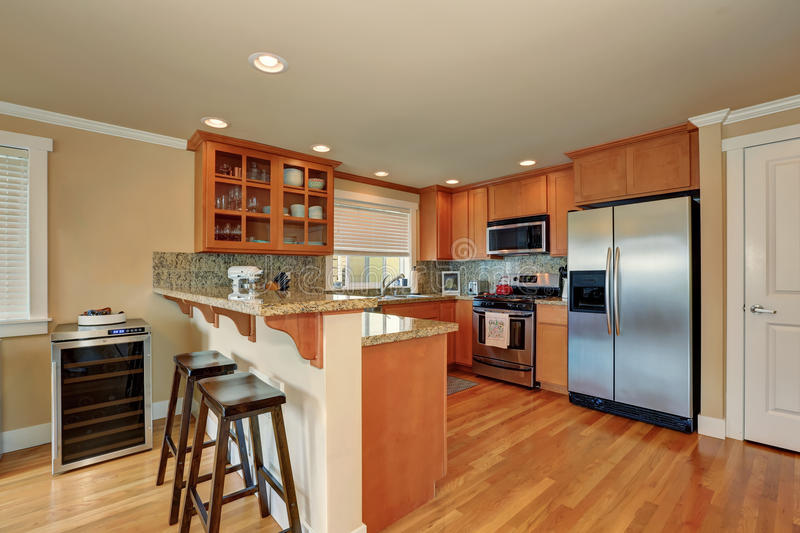 Bright wooden kitchen interior with steel appliances. And bar stools. Northwest, USA stock photo