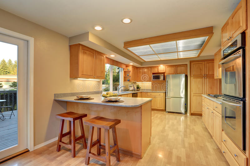 Bright wooden kitchen interior with steel appliances. Bright wooden kitchen interior with skylight and steel appliances. Northwest, USA royalty free stock photography