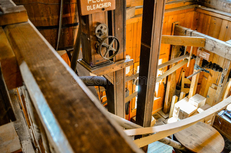 Bright Wooden Mill. Inside of a wood mill with bright daylight shining throw the windows stock photography
